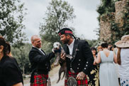 Groom with puppy on wedding day