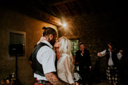 Bride and groom kissing after first dance