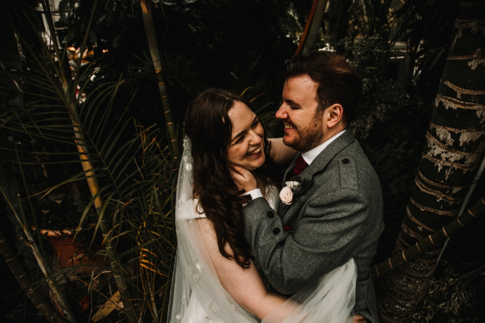 couple laughing in the palms at sefton park wedding venue