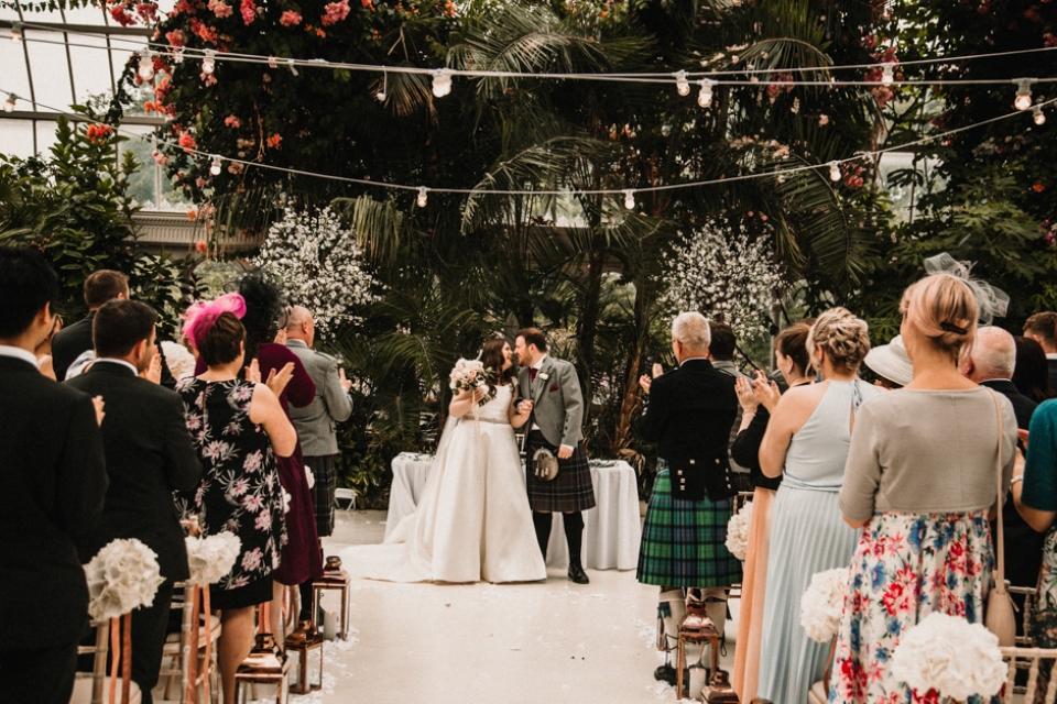 bride and groom walking down sefton wedding venue aisle