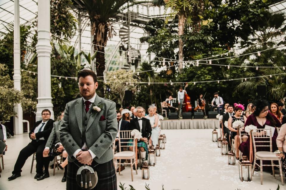 groom nervously awaiting bride