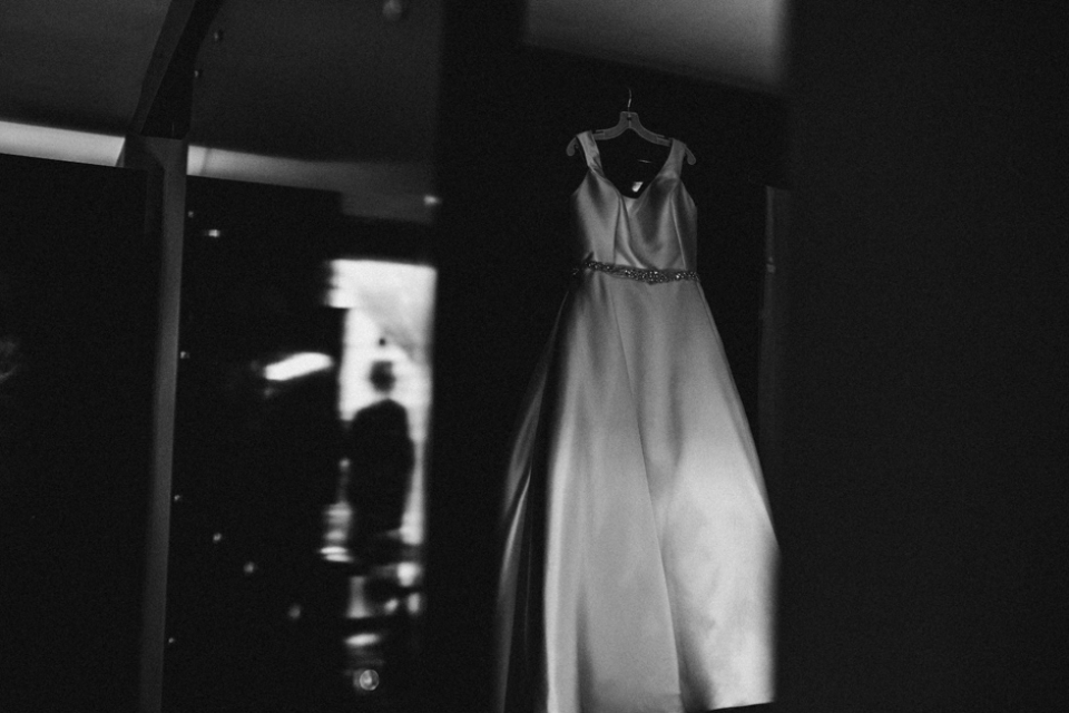 brides dress hanging on wardrobe at the malmaison hotel , liverpool