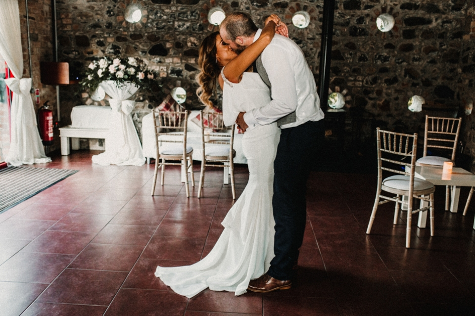 first dance bride and groom kissing on dance floor