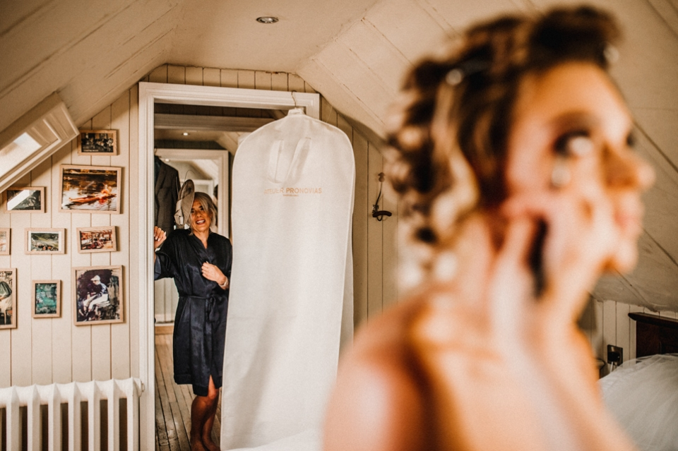 brides mother admiring her daughter during bridal prep