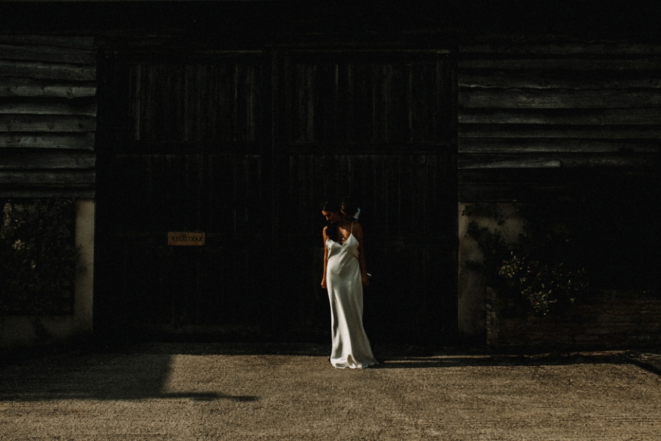 creative portrait with modern bride in the row wedding dress at Merris court wedding venue
