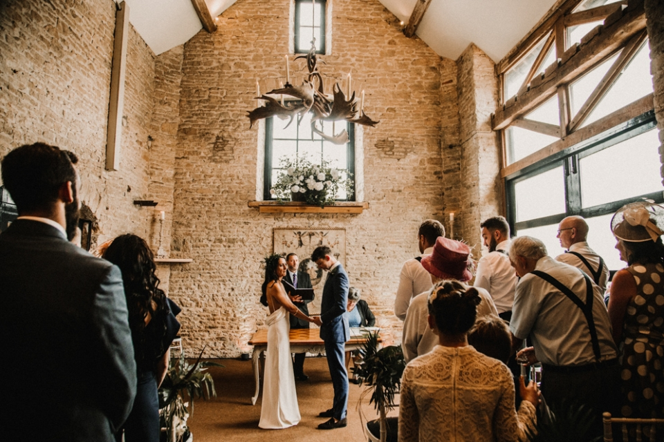 bridge and groom at the stone barn wedding ceremony in Merris Court