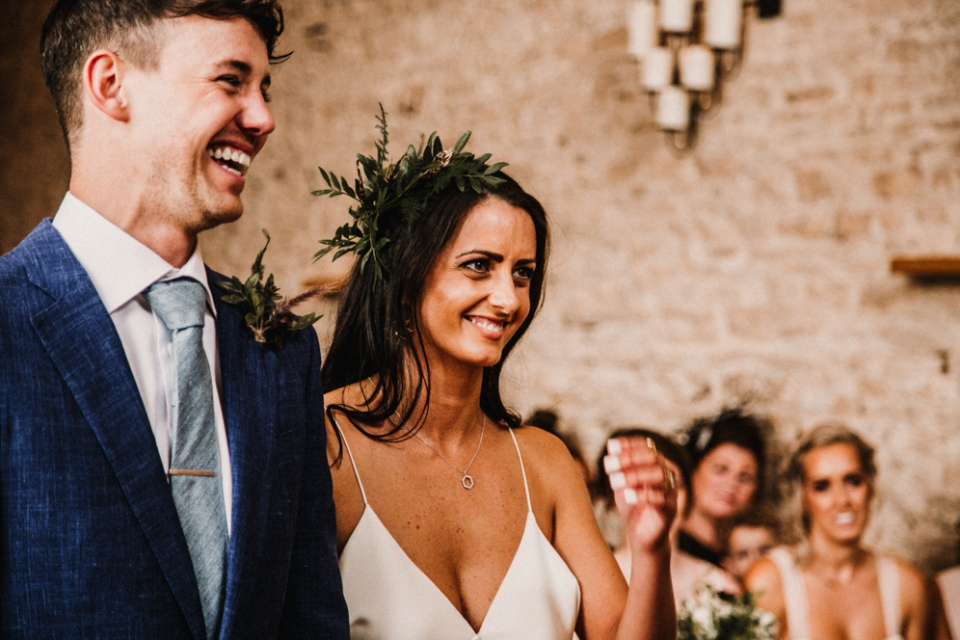 bride and groom during wedding ceremony at Merris court stone barn