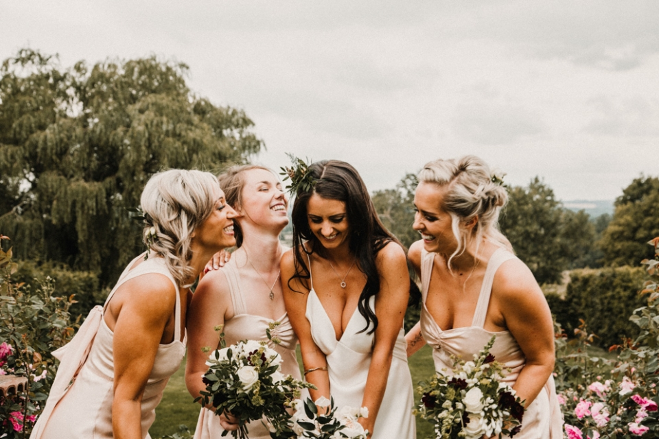 bridesmaids having a giggle at Merris court wedding venue , relaxed portraits