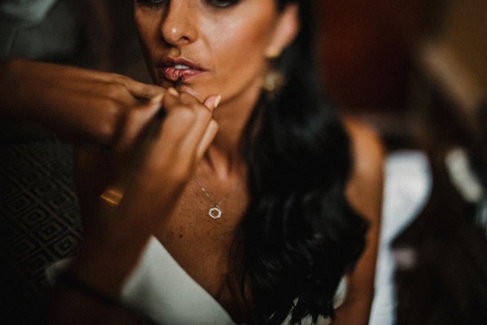 bride having her makeup done in Woodstock wedding