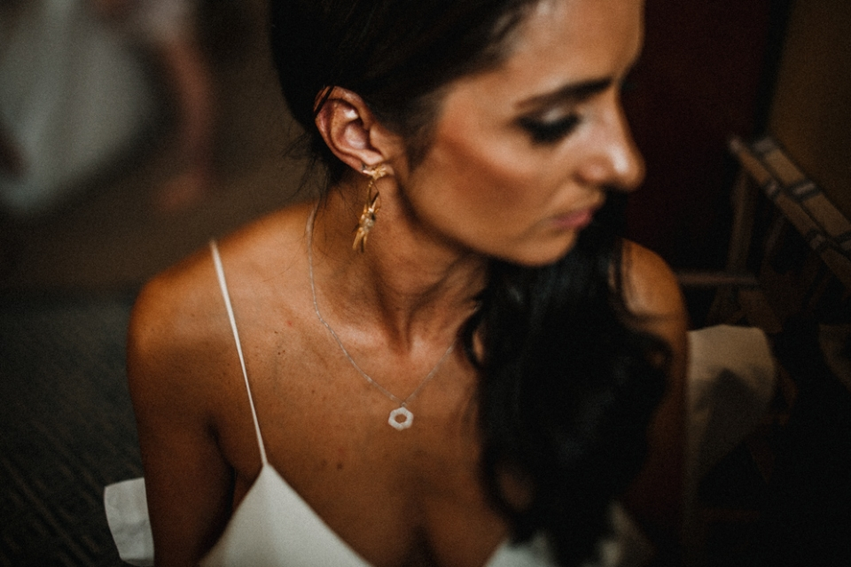 bride having her lipstick applied , london wedding