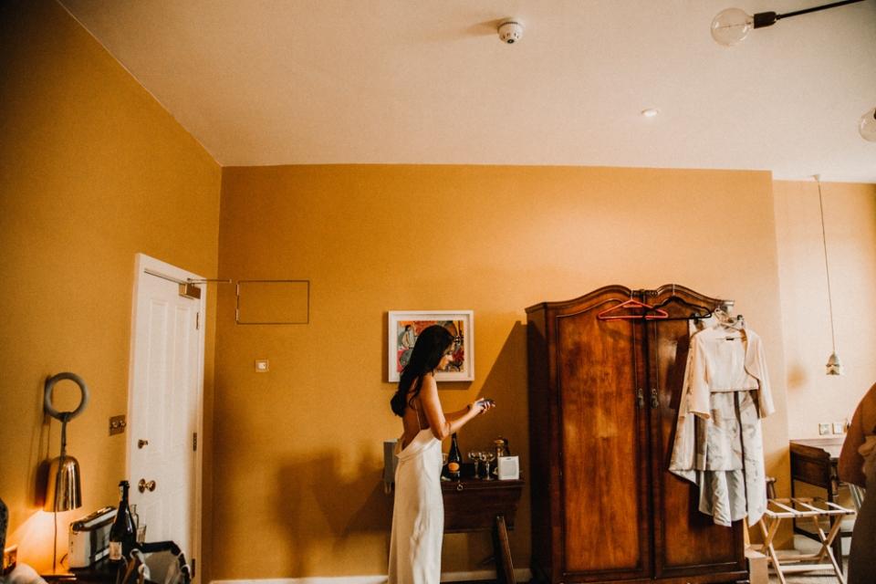 BRIDE DURING BRIDAL PREP AT MERRIS COURT