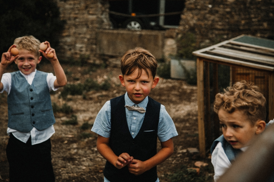 page boys picking eggs at the wedding reception