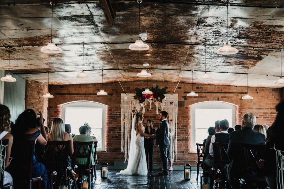 ceremony , bride and groom exchanging wedding vows , west mill wedding venue