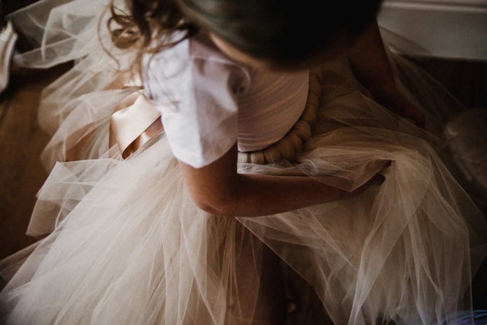 flower girl putting her dress on in the west mill bridal suite