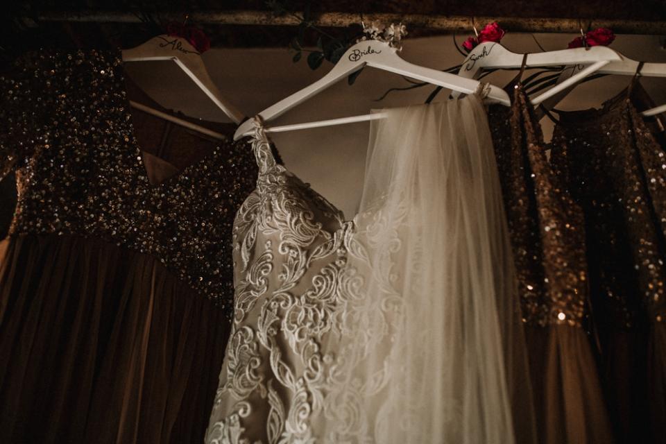 bridesmaids dress and brides wedding dress hanging at west mill