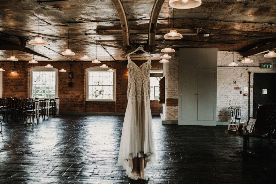 bridal gown hanging at the west mill
