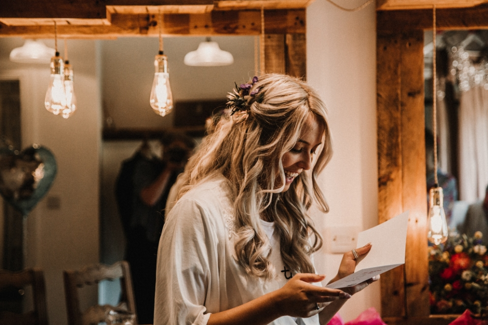 bride reading her card from her husband , derby wedding photography
