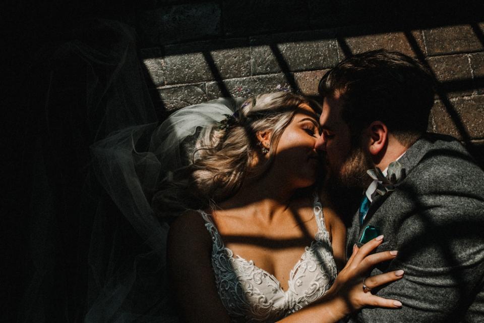 intimate couple portrait in alternative light , west mill
