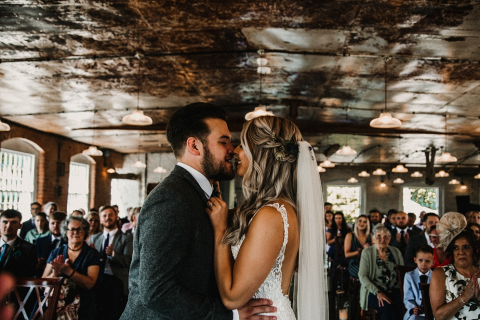 first kiss at industrial derby wedding ceremony