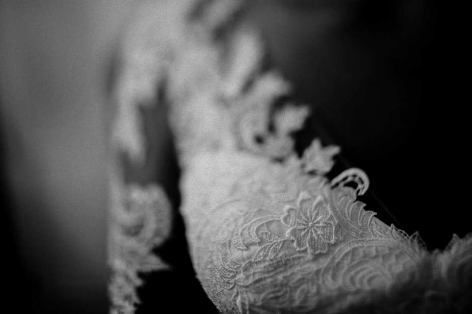 bridal wedding gown close up , black and white wedding photography.