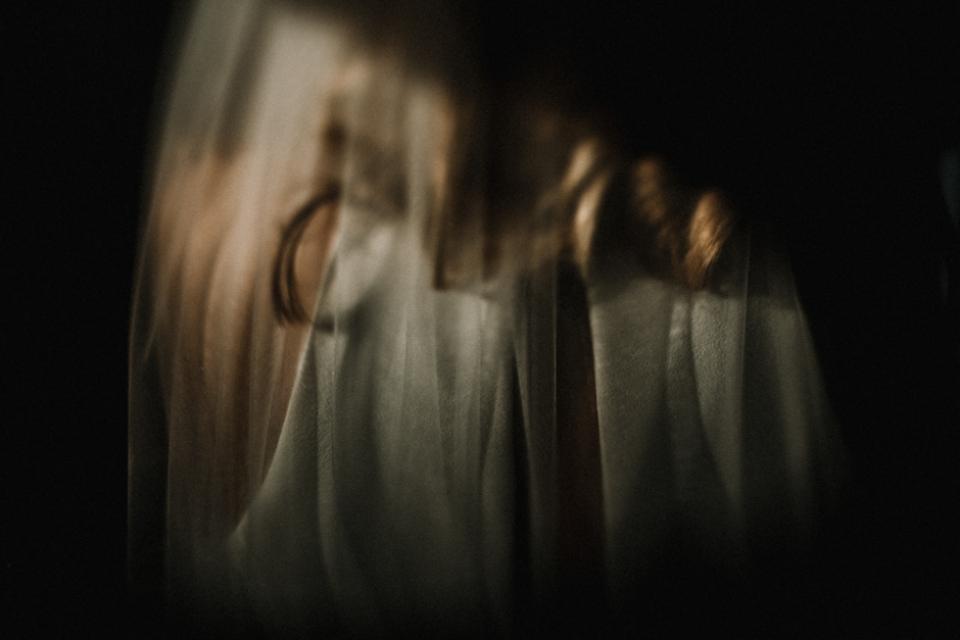 creative veil portraits with bride during bridal prep