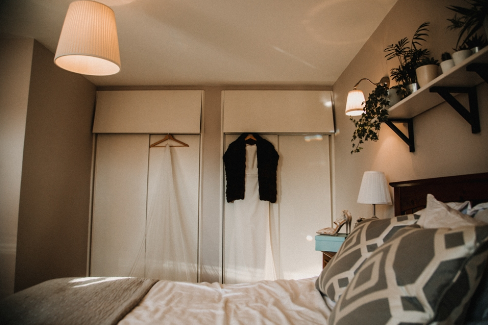 bridal gown hanging in modern bedroom , wedding photography in scotland