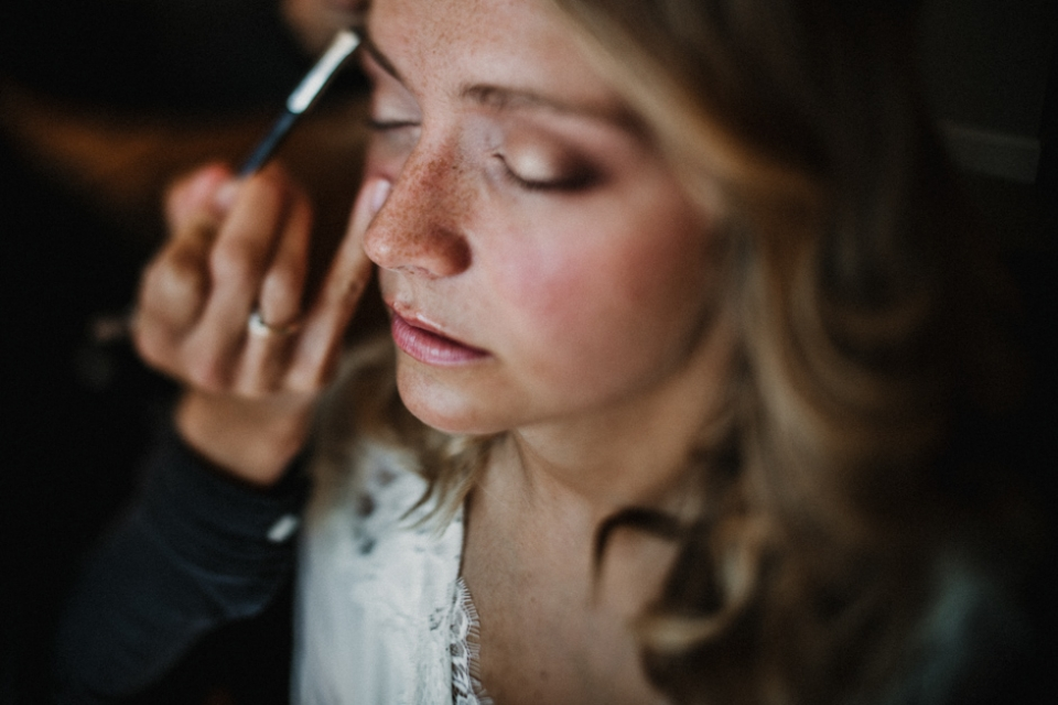 bride having her makeup done , glamours bohemian bride