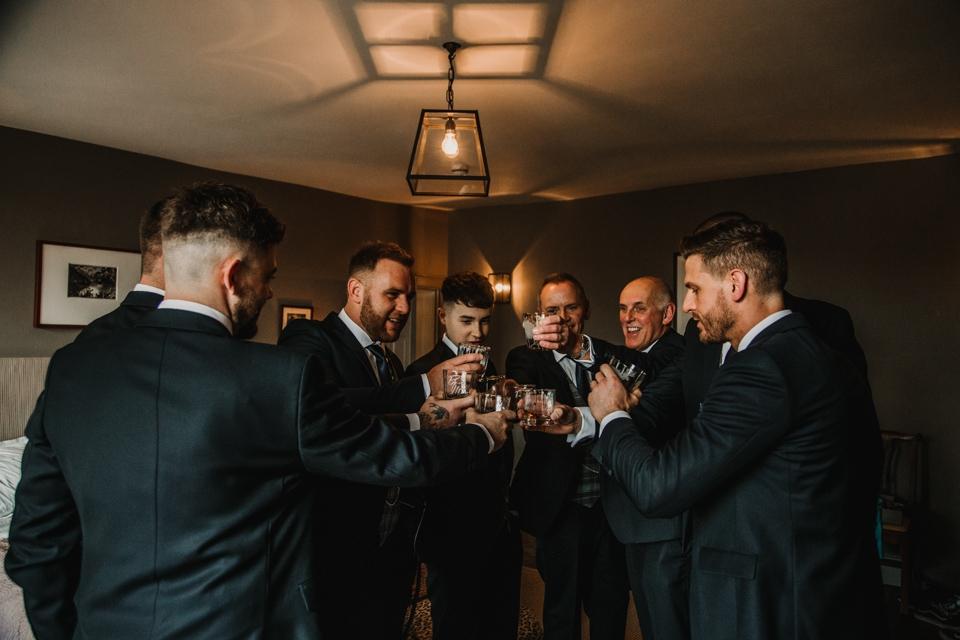 groom enjoying a drink