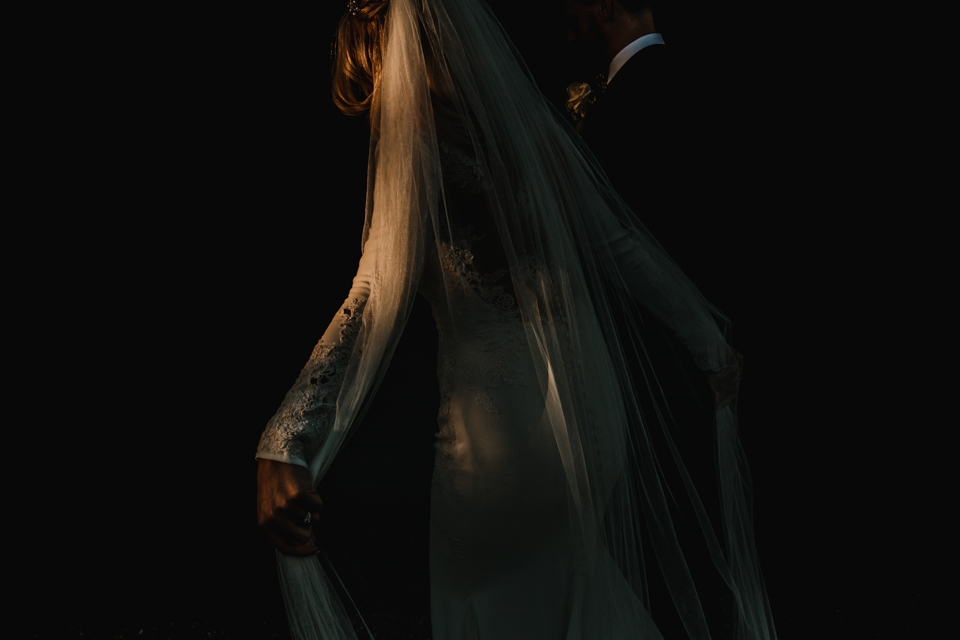 beautiful light highlighting brides veil and pronovias dress