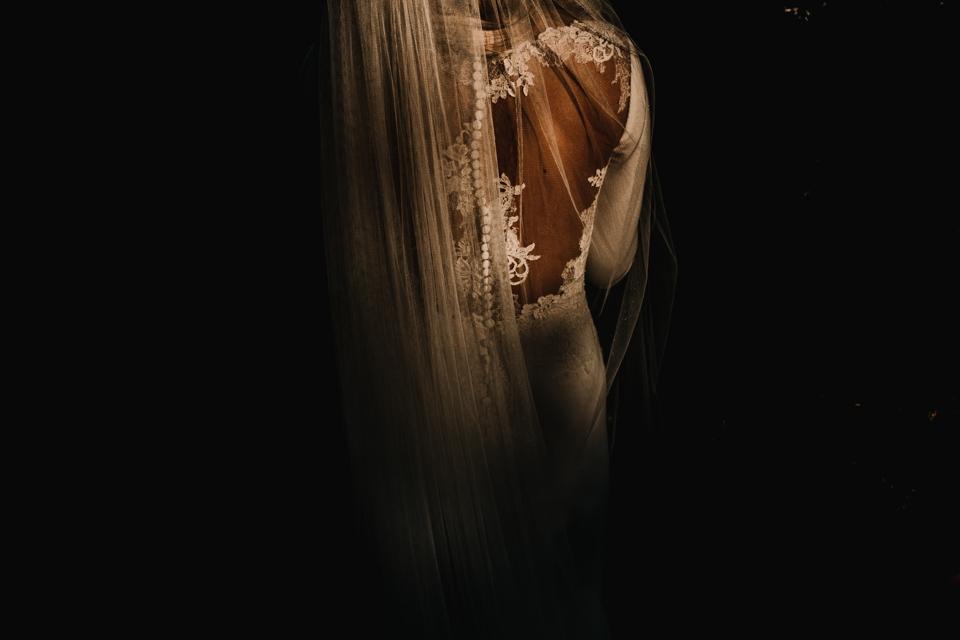 light and shadow on pronovia wedding dress