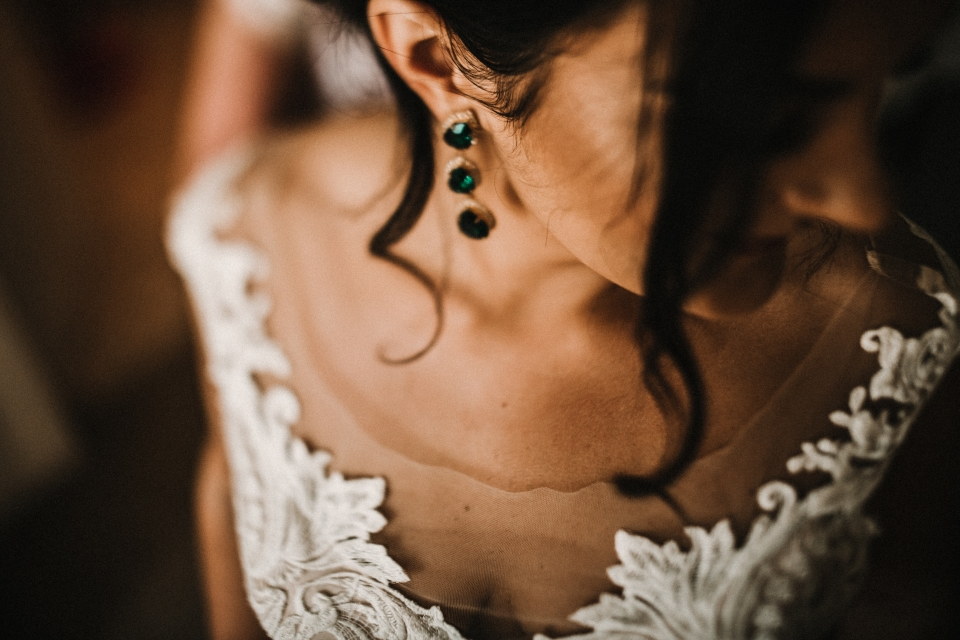 rock my wedding supplier allure wedding dress and emerald earrings