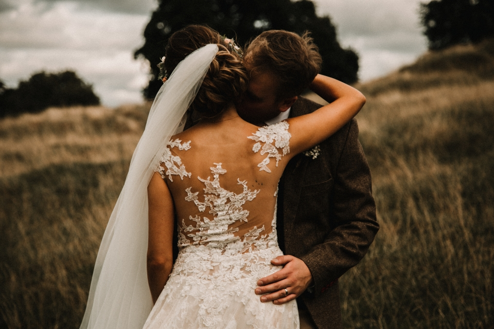 beautiful bohemian wedding gown and intimate portraits , kingscote barns