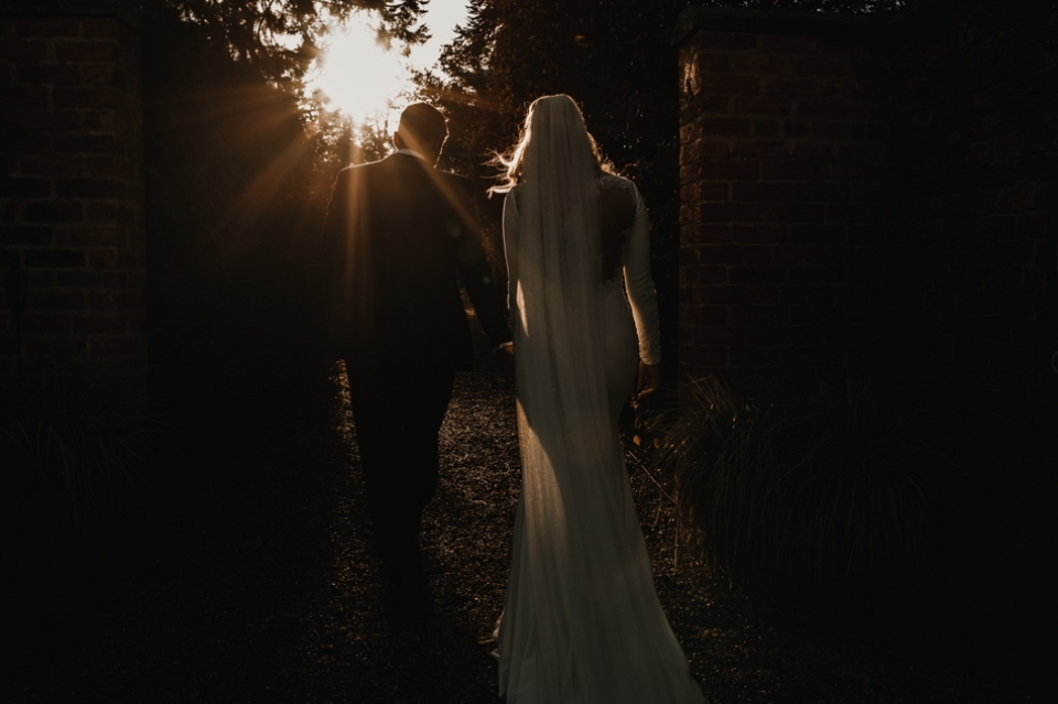 sun light and bride and grooms in Iscoyd park