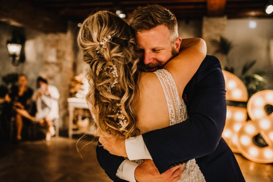 intimate moment between bride and groom as husband and wife , first dance