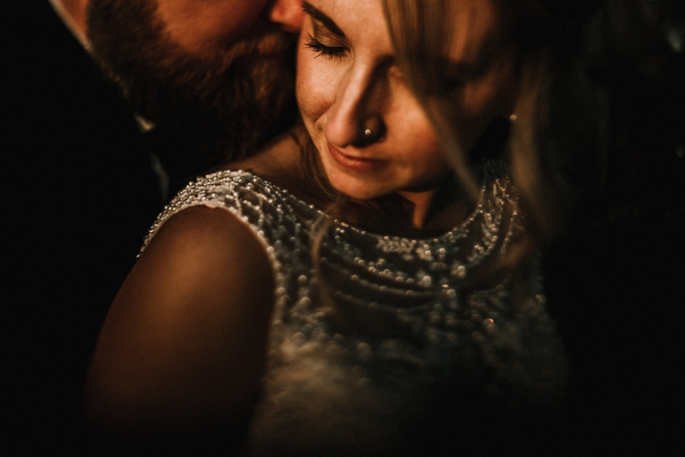 creative intimate portrait of brie and groom during golden hour