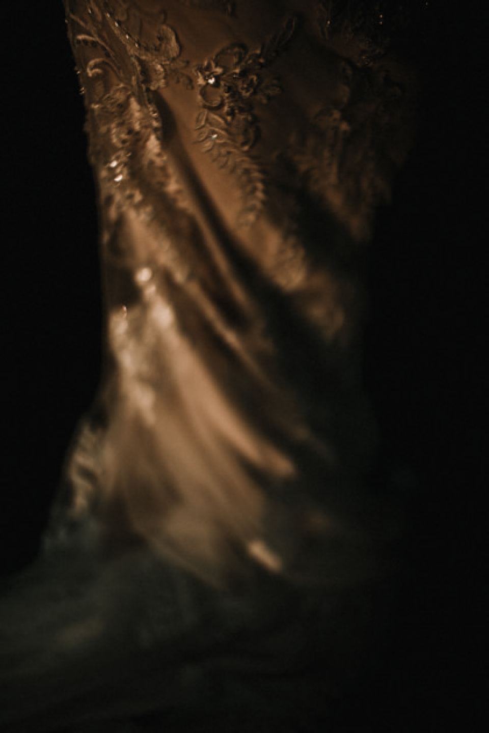 close up of brides dress in golden hour