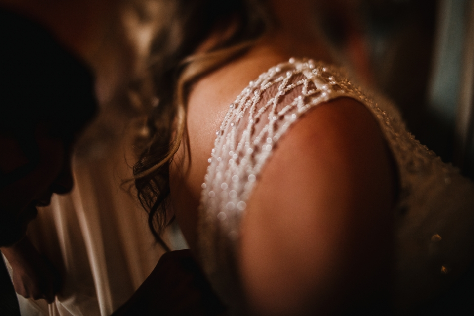 creative free lensed image of brides shoulder bead detail