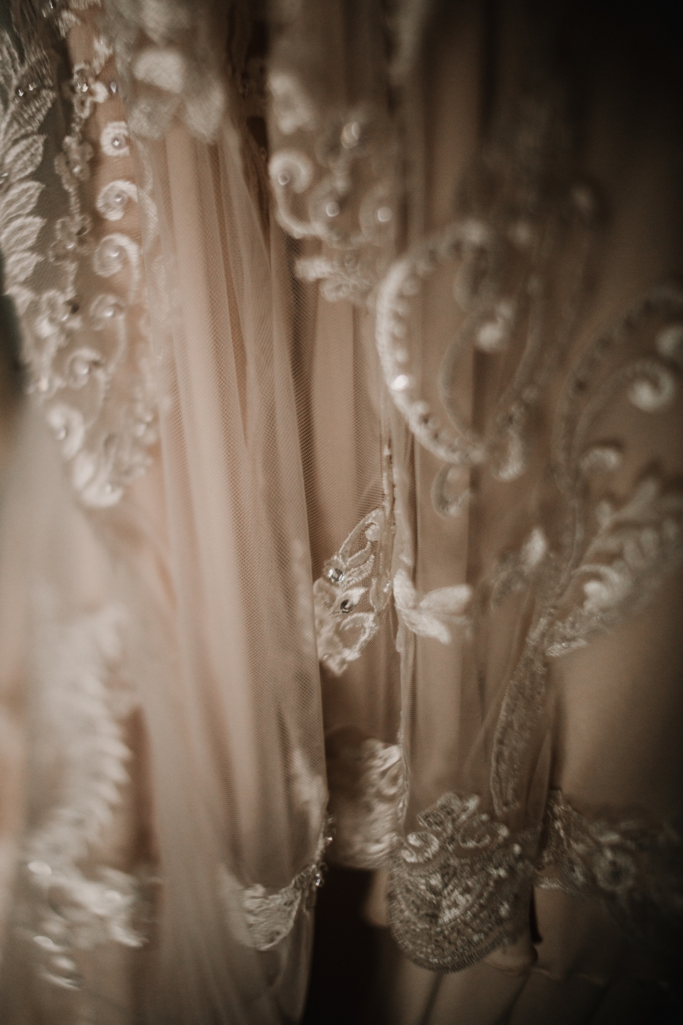 close up detail of the textures in brides wedding dress