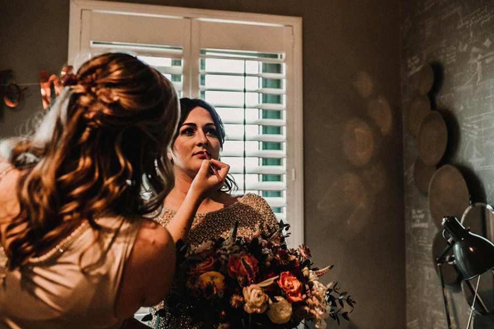 bride having final makeup touch up