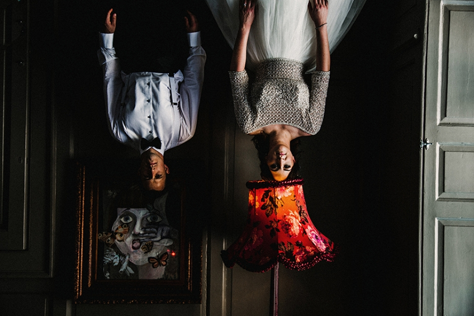 bride and groom , quirky image of them hanging upside down in oddfellows venue