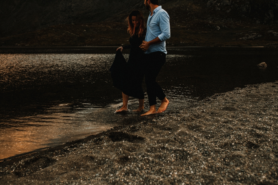 cwm ideal pre wedding shoot in mountains , couple walking in the icy lake
