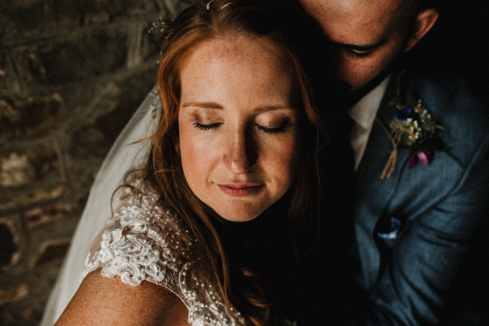 bride and groom by the boat house , buckland house wedding