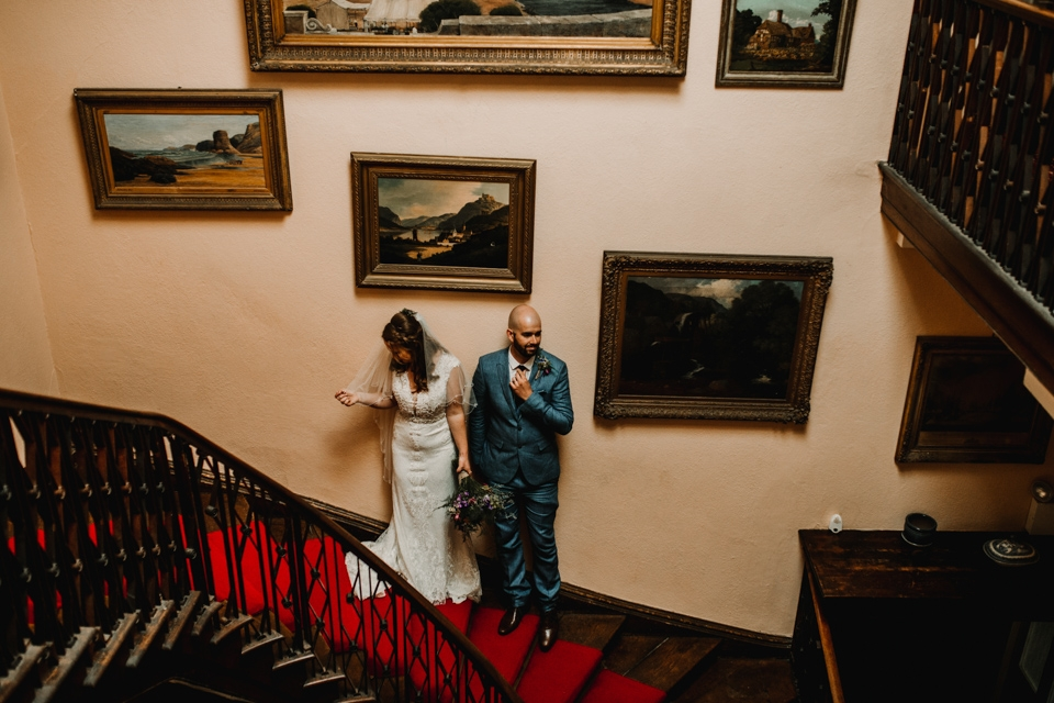 beautiful staircase bride and groom portraits