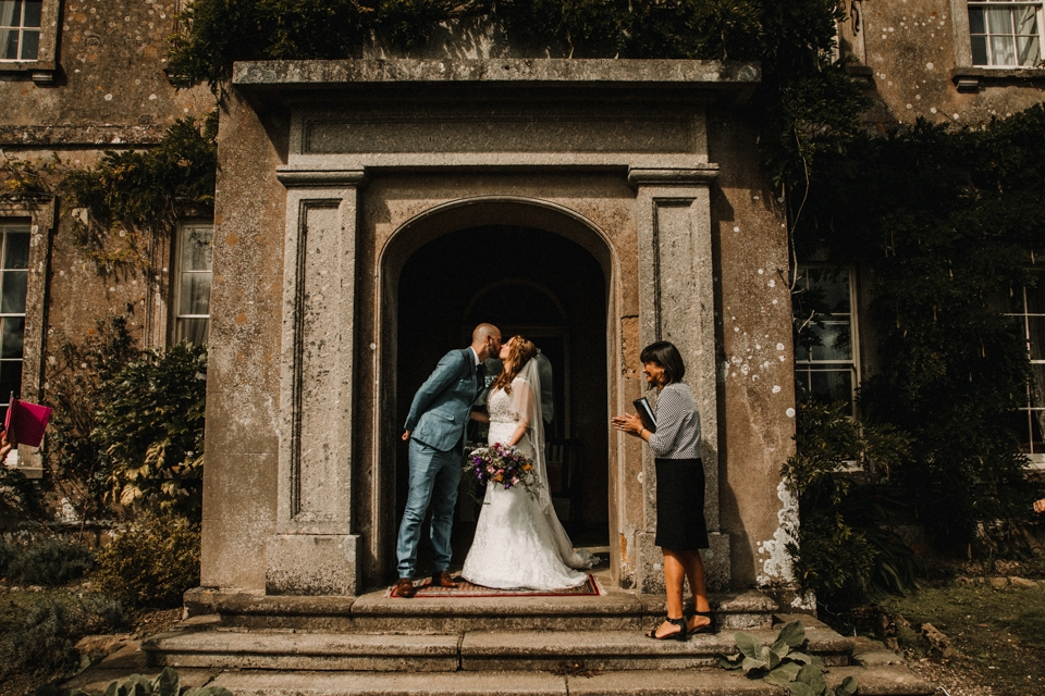 bride and grooms first kiss buckland house