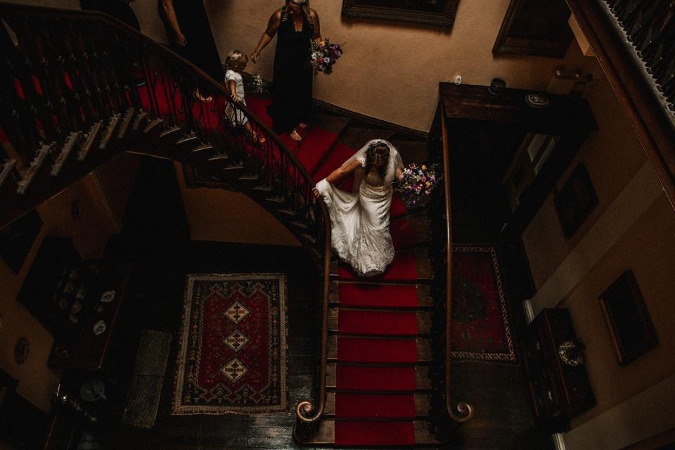 bride walking to the ceremony in devon wedding venue