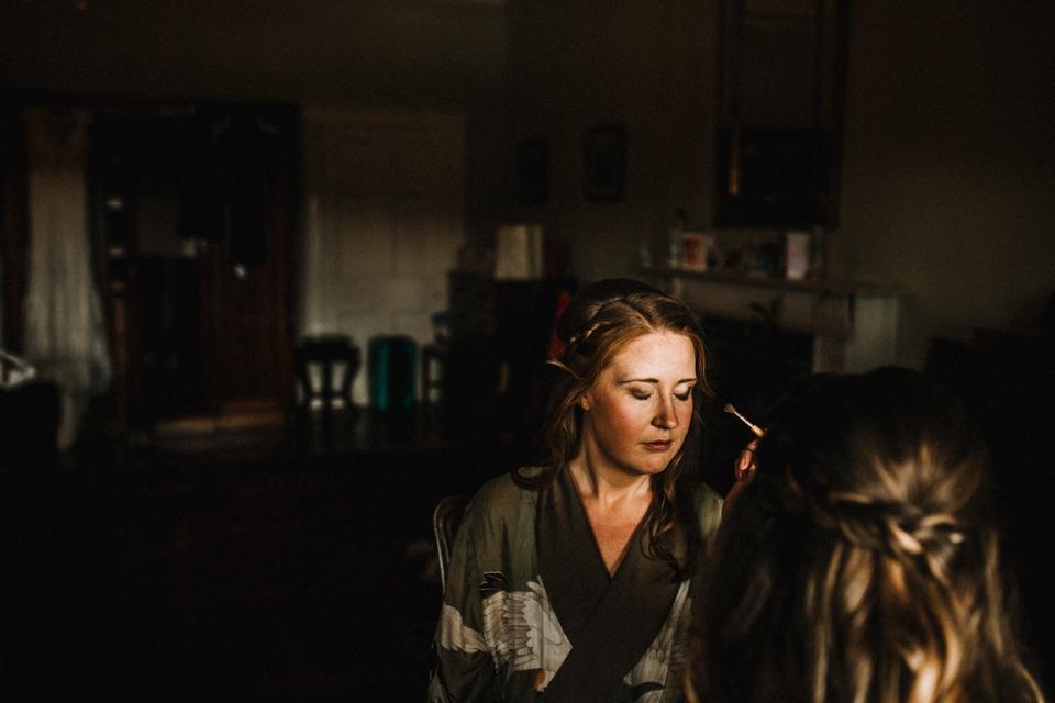 bride having her makeup done at devon wedding photographer