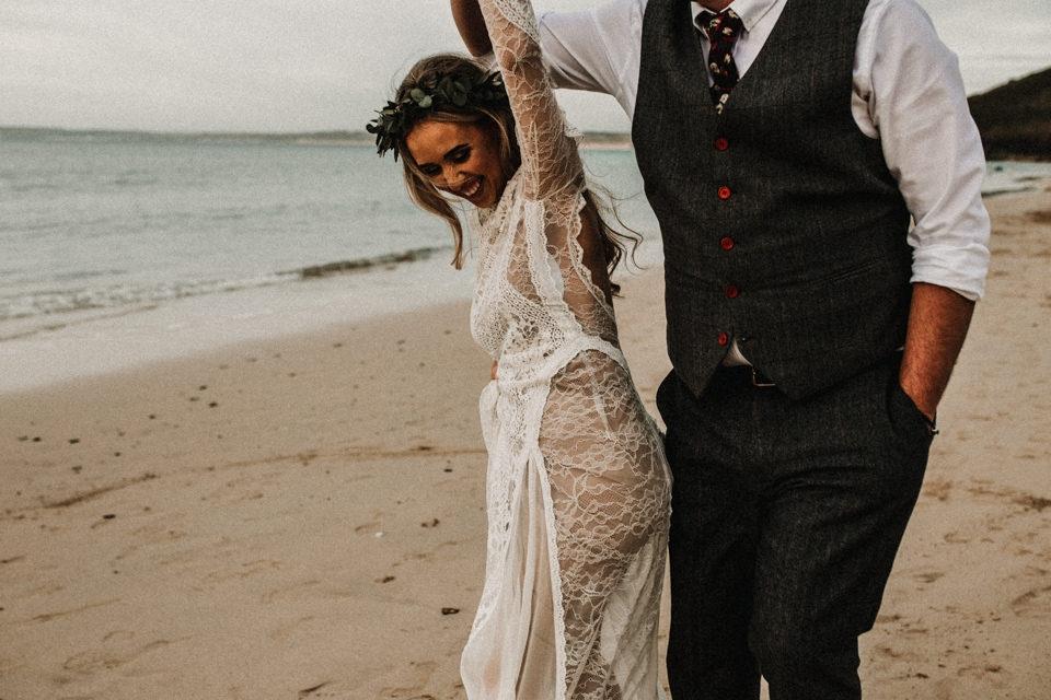 bride and groom playful beach portraits