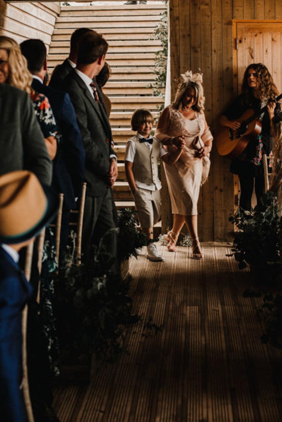 bride and grooms son as page boy in carbs bay wedding ceremony