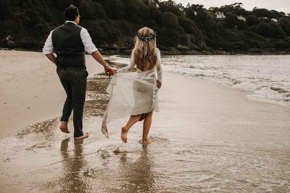 carbs bay st ives wedding day couple portraits , bride walking in the sea