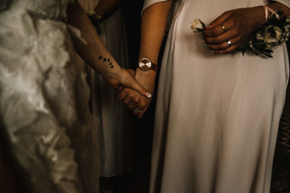 bride and bridesmaid having a moment before the wedding ceremony